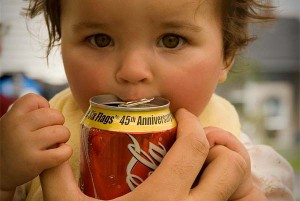 Child drinking cola